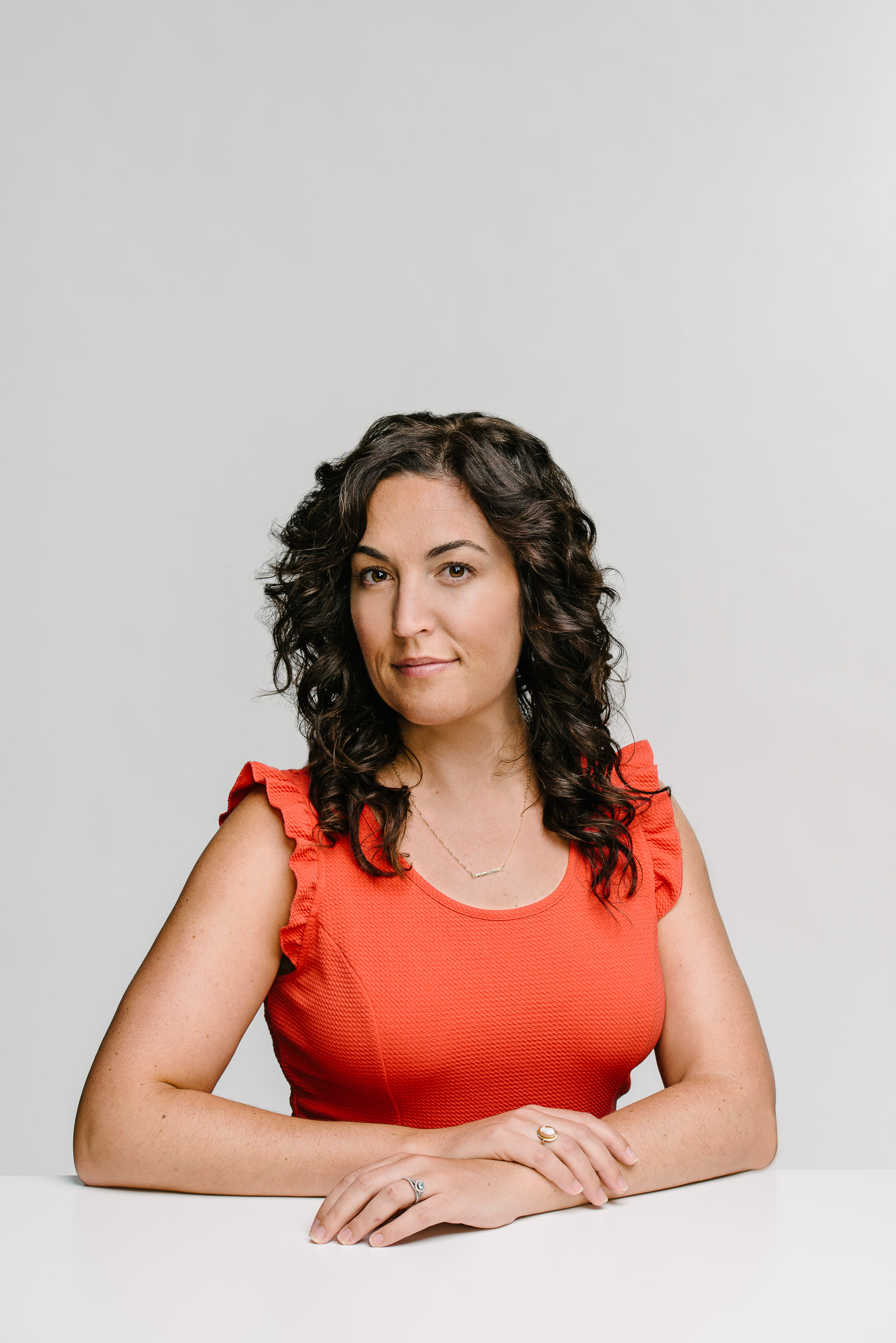 Executive headshot against neutral backdrop - Lacy Jansson