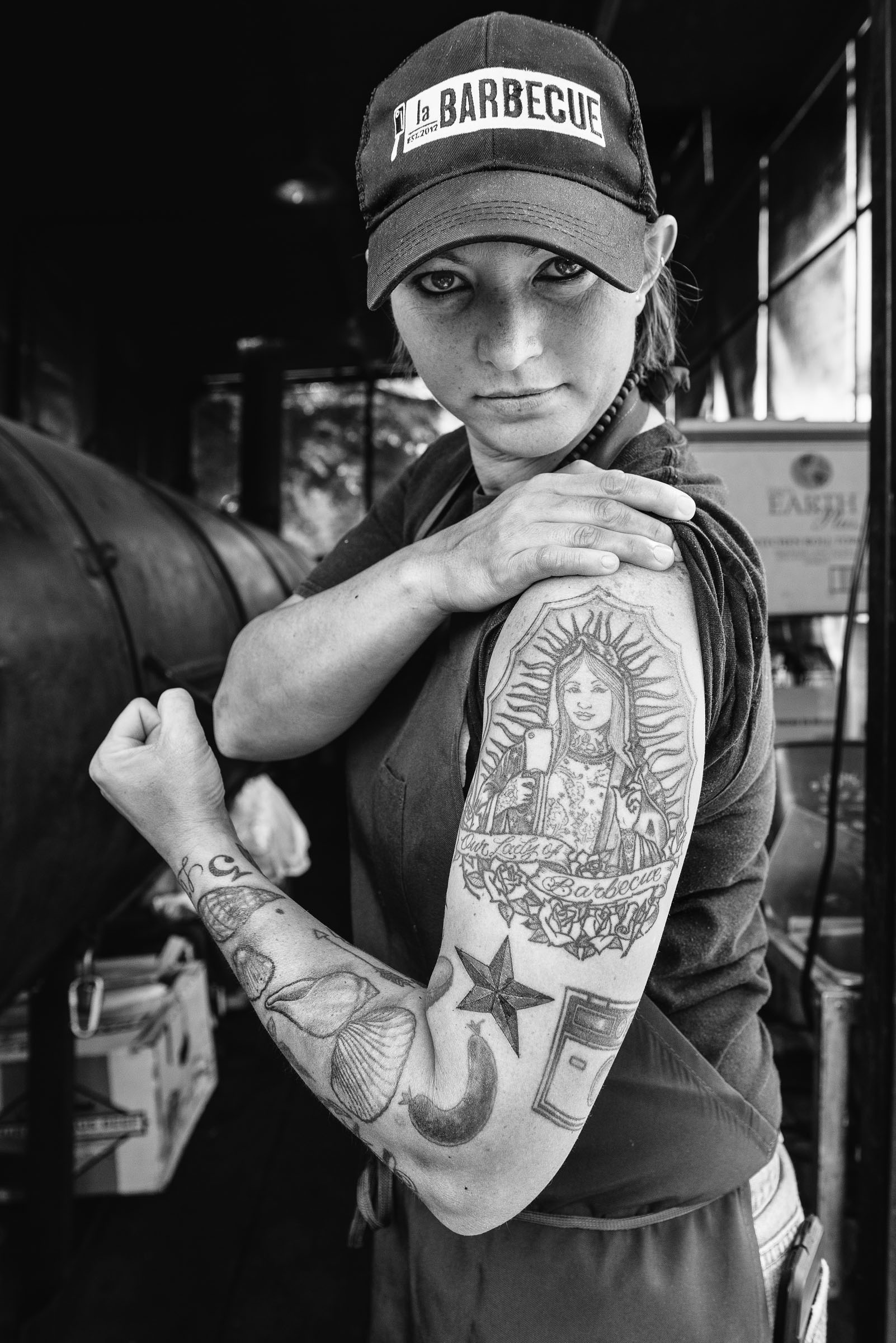 Portrait of Ali-Clem-Co-owner-LaBarbecue-Austin-TX -  displaying her arm tattoo.