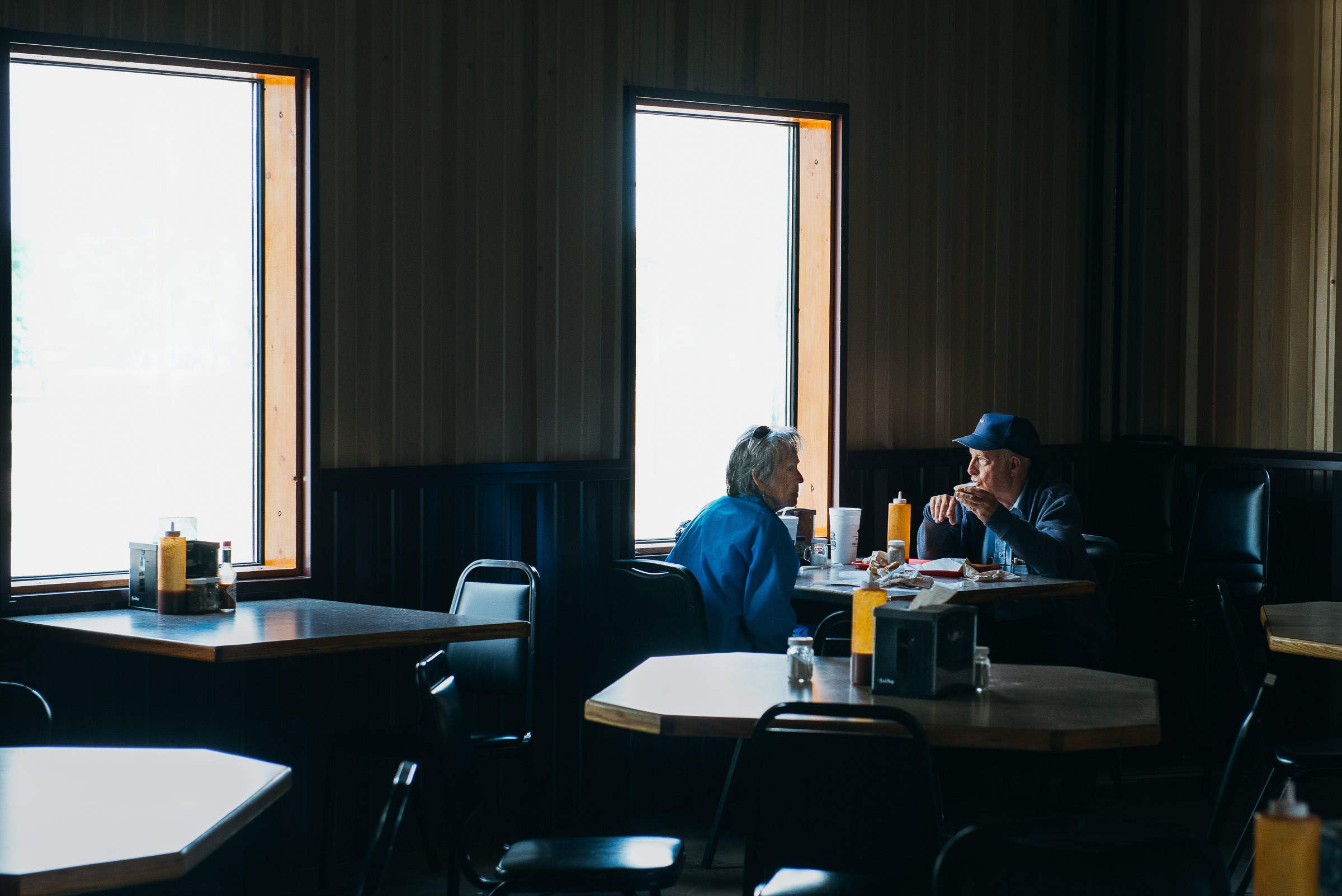 Cinematic image of a lone couple dining  at Baker-Boys-BBQ-Gonzales-Texas.