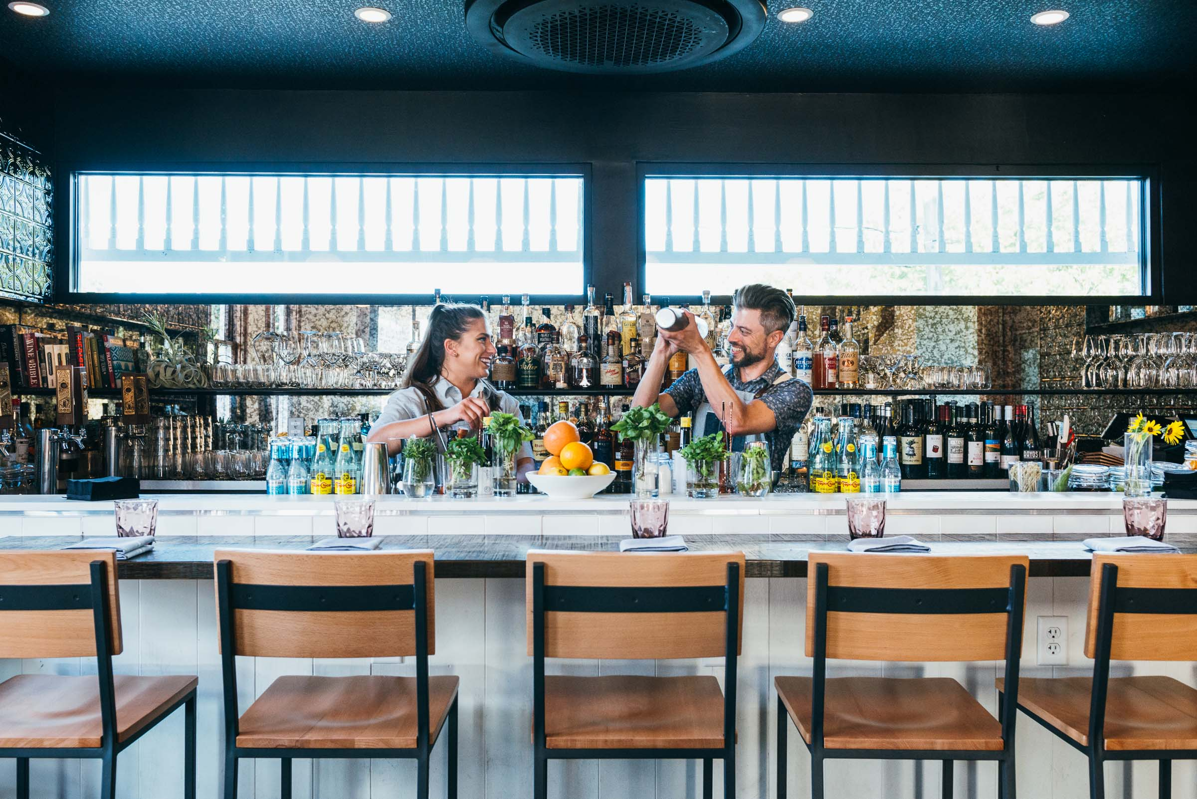 Bartenders- in interesting architectural space - Rosewood Restaurant Austin TX