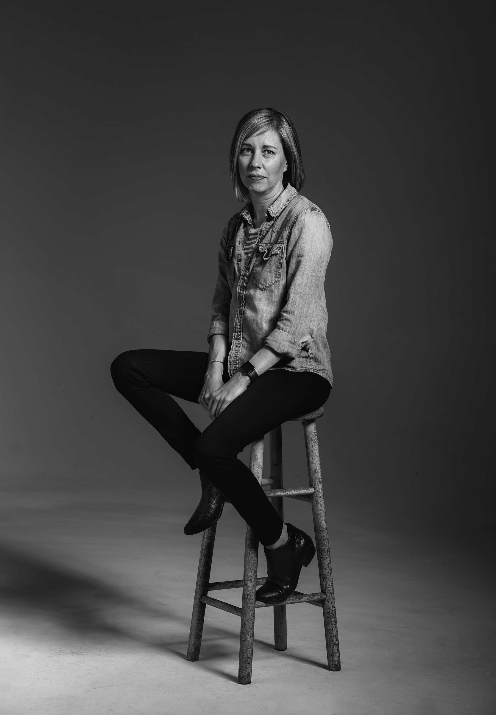 Diversity #metoo porrtait - Christy-Caroll,  seated on a stool in black and white image