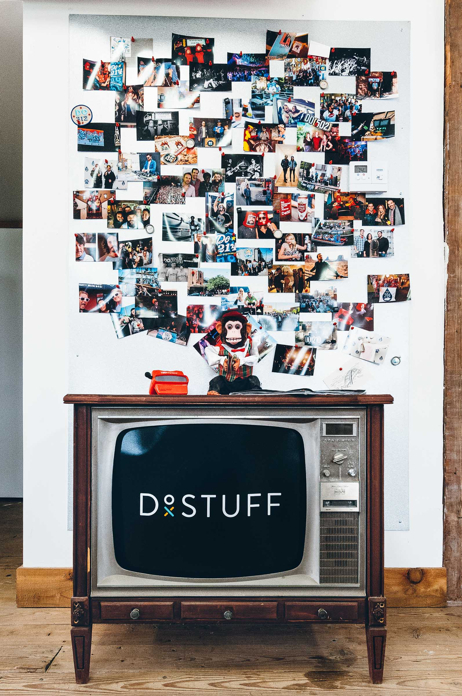 A toy monkey, a vintage TV, and staff photographs - work culture at Do512