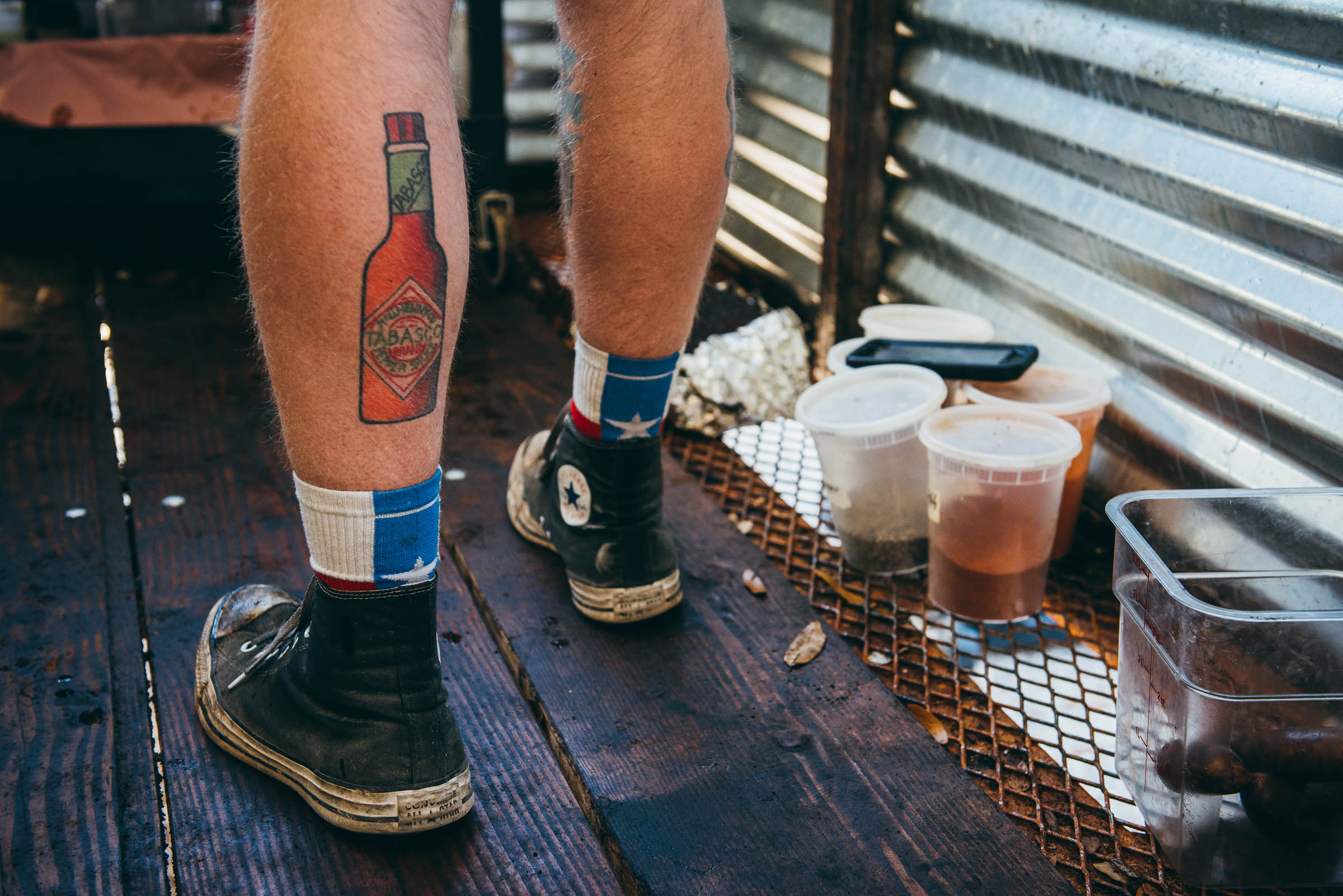 Tattoo of a Tabasco bottle on Texas Pit-master Phillip Helberg