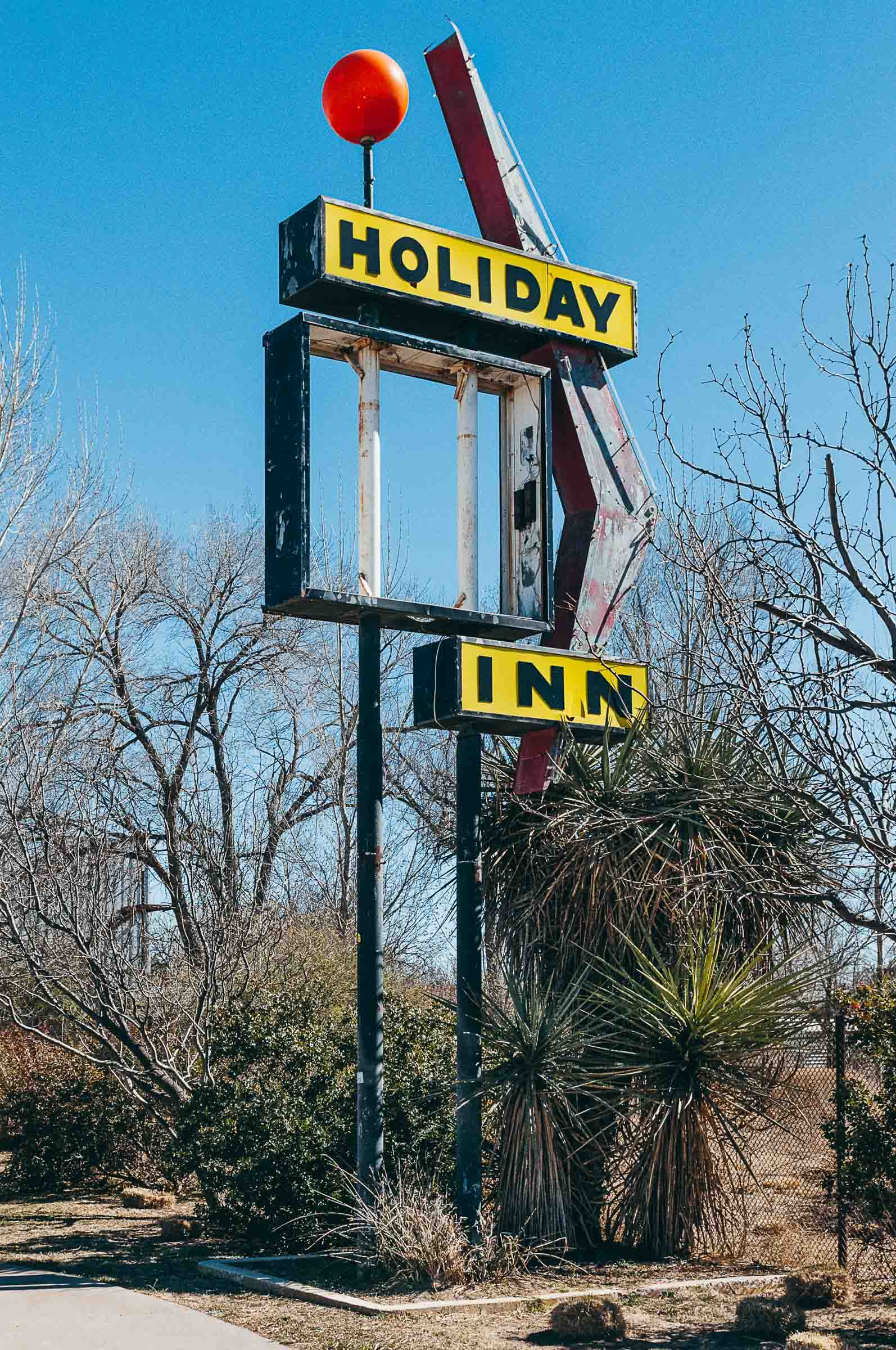 Disrepair vintage Holiday Inn sign in bright sunlight -Marfa-TX