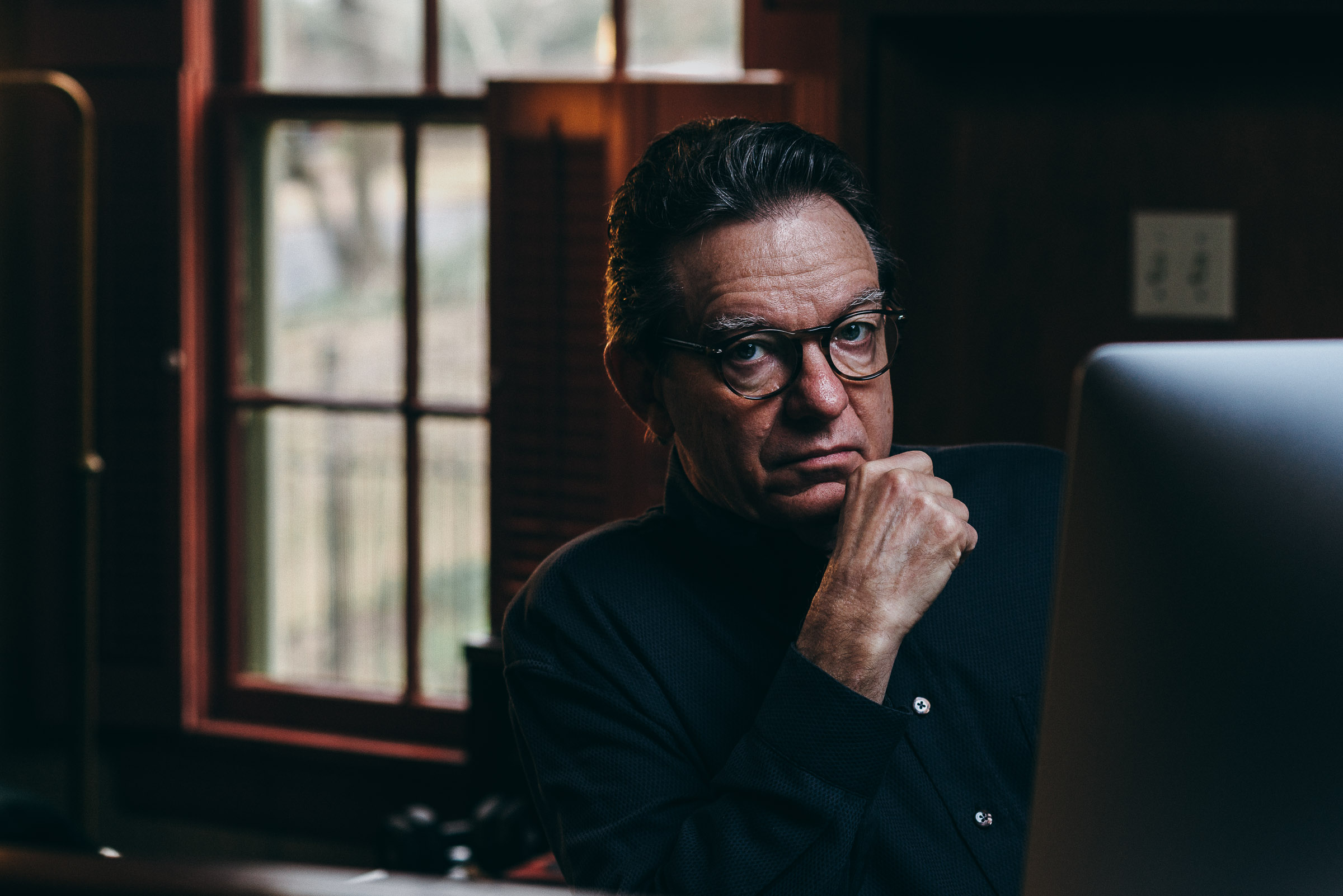 Editorial portrait - Lawrence Wright - author at his desk