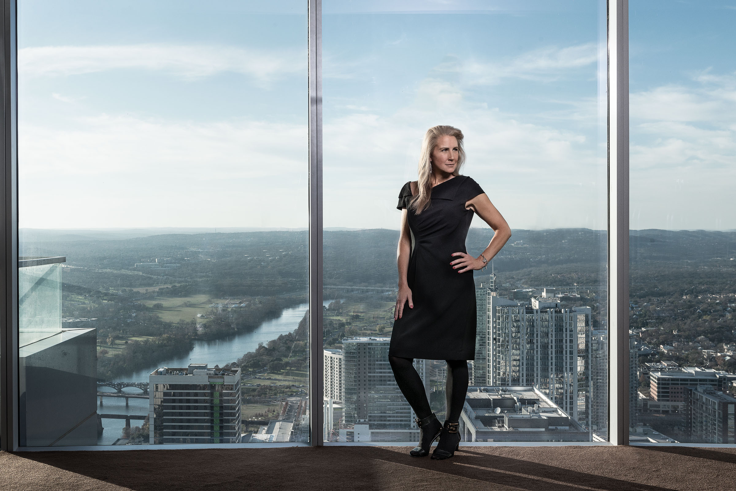 Executive portrait Austin, TX - Michelle Skelding before panoramic 54th floor views.