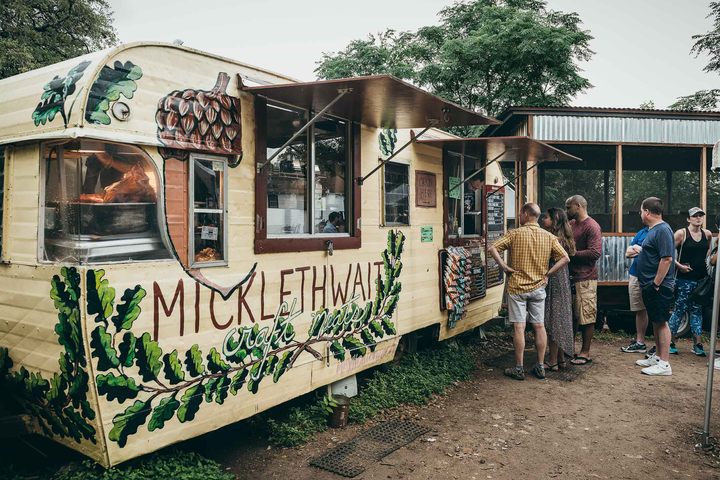 Mickelthwaites BBQ  trailer, with a line of hungry customers -East  Austin-TX.