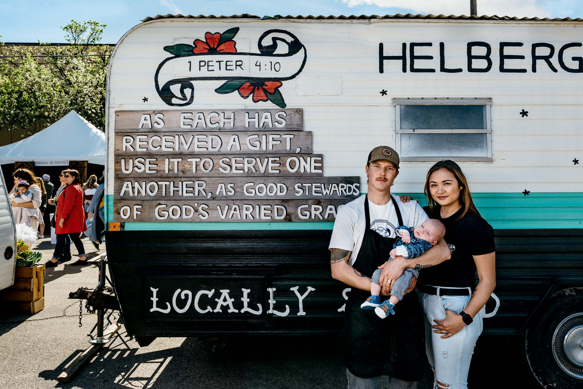 Phillip-and-Evette-Helberg-with newborn baby in front of their food truck -BBQ-Waco-Texas