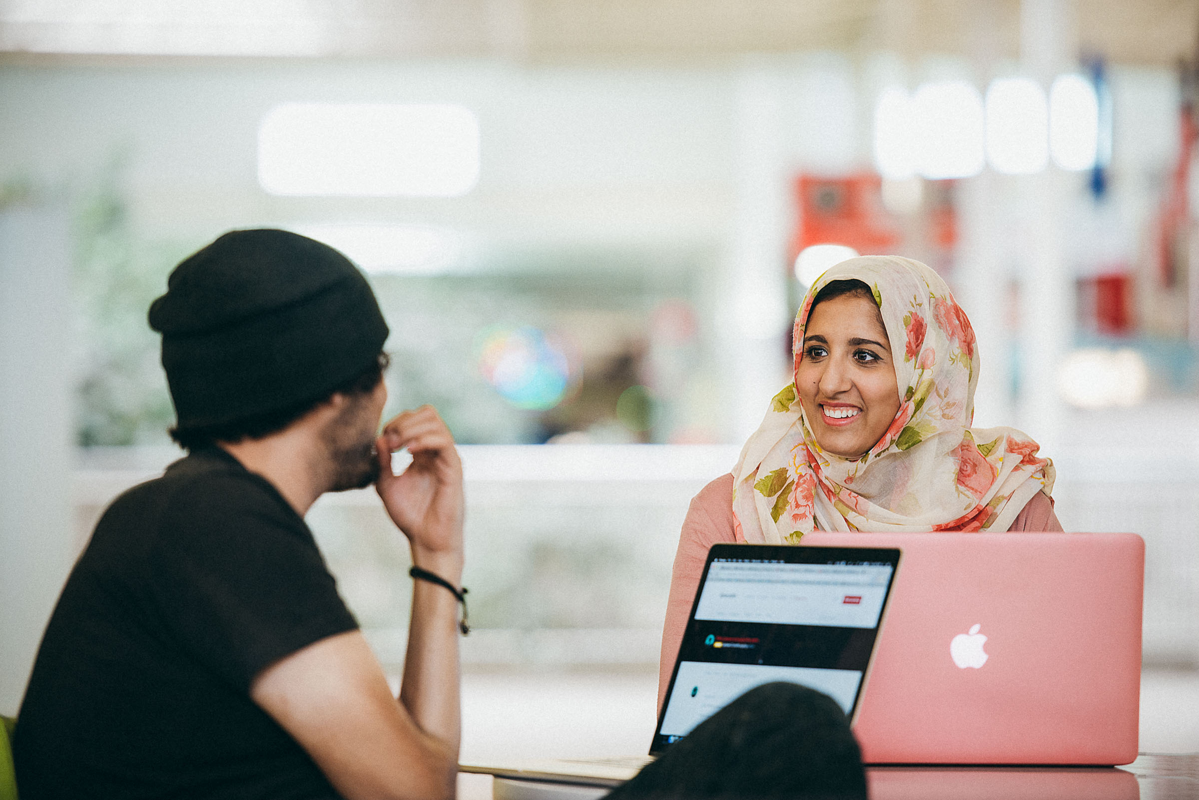 Diversity in tech/lifestyle photography - two colleagues chat at Rackspace San Antonio.